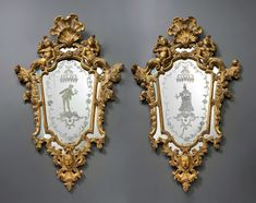 A pair of Venetian Rococo engraved mirrors in frames