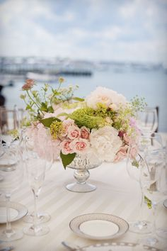 Loving this centerpiece in vintage vase and with pale color pallet!!