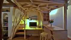 Living in a shoebox | This small studio apartment alternates as a wooden sculpture