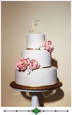 "Small white brides cake with fondant and pink sugar flowers and custom ""D"" cake topper - Photo by Devon J. Imagery"