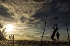 Children playing football in Zanzibar. by Dan Mirica
