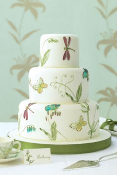 Wedding cake handpainted with butterflies, dragon flies, and flowers
