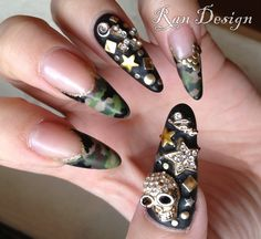 Camouflage fashion is inescapable this season, but pulling it off the right way is key. Skeleton army nail art, anyone? #nailart #nails #camouflage