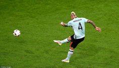 Radja Nainggolan smashes the ball goalwards from distance, a blistering strike that flies ...