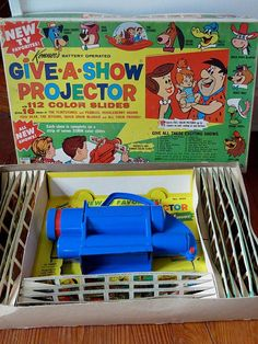 1962 Kenner Give-A-Show Projector with 112 slides giving 16 shows that included The Flintsones, The Jetsons, Huckleberry Hound, Quick Draw McGraw & more.