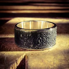 Custom made wedding band by Julie Bégin. 18k gold and sterling silver.