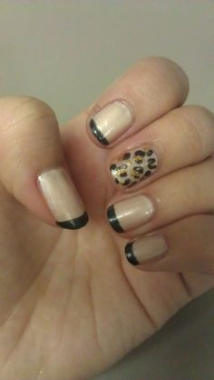 Cream with black tips, plus one cream/gold/black leopard print nail