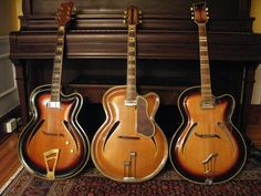 Trio of carved Roger guitars