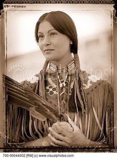Stunning Cree woman. Notice the traditional Cree flowers on her dress :)