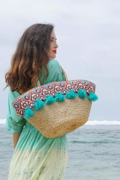 ** Sofia Straw Beach Bag ** Straw Bag decorated with hand made brass beads, whelks and wool tassels. Straw Beach Tote, Beach Tote Bags, Straw Bag, Glands, Diy Tote Bag, Basket Bag, Messing, Handmade Bags, Tassels
