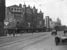 Grand Opera House, The Hippodrome (Odeon), and The Ritz (ABC). In the foreground is a motorcycle and sidecar and a jeep.  5/10/1942 BELFAST TELEGRAPH COLLECTION/NMNI