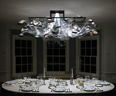 Biologically Living Chandelier Formed Within Petri Dishes