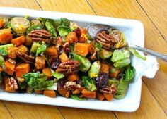 Fall comfort food at its best - a recipe for Orange Glazed Brussels Sprouts & Butternut Squash with black pepper dusted pecans and dried cranberries.