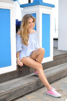 Blue blouse, white shorts and pink Converse
