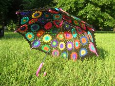 Granny Square Umbrella- In theory, this could never work. It lets the rain in, it lets the sun in... then again, it will let the awesome in as well...