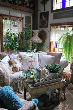 elements to use: lace, pillows, crowded coffee table, plants, color, art, rug; plants; high ceiling.