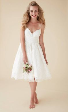 Short, sassy, and all lace...Astrid & Mercedes Jolie cocktail length wedding dress.