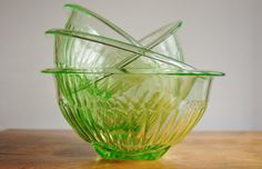 This is a gorgeous set of uranium glass mixing bowls by Anchor Hocking. Each bowl in this set of 4 vaseline glass mixing bowls has a squared