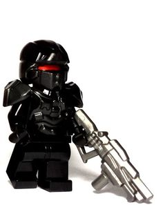 Corporate Shotgun - For Galaxy Enforcer minifigs, every day is take your weapon to work day. And when you're in the business of taking down enemies of the galaxy, the Corporate Shotgun is a good weapon to employ. With a sleek design and multiple grips, this custom LEGO gun will do well to uphold the standards of the corporation, evil or otherwise. #LEGO #Minifigure #BrickWarriors #LEGOGun #MinifigureGun #CorporateShotgun #Shotgun #SciFi #GalaxyEnforcer #LEGOAccessories #Space