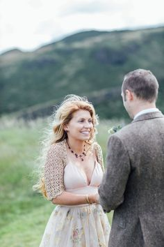 The bride wears a crocheted cover up for her Scottish elopement. Photography by Carley Buick.