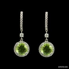 These eye-catching peridot and diamond earrings are simply stunning. Each earring comprises of a 1.50ct round cut peridot, 4 claw set in a delicate round cut diamond surround. The dramatic cluster is suspended from a diamond set hoop with the lovely feature of a single round cut diamond separating them. The total diamond weight is .71ct and this beautiful piece of jewellery could not fail to impress on an August birthday. £1995