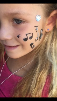 Musical notes face paint by me  (funnybunnyentertainment/ms scarlett makeup and hair)