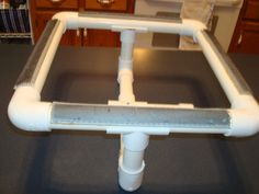 Is that a DIY rug hooking frame made from PVC pipe? Ingenious!