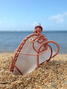 Beach Glass Jewelry, Wire Wrap Sea Glass Pendant, Frosted Clear, Copper Bronze Two Tone, Handmade in Kauai Hawaii, Beach Love by BeachBaubles1 on Etsy https://www.etsy.com/listing/249811832/beach-glass-jewelry-wire-wrap-sea-glass