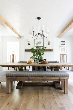 Long cushioned bench on side of dining table
