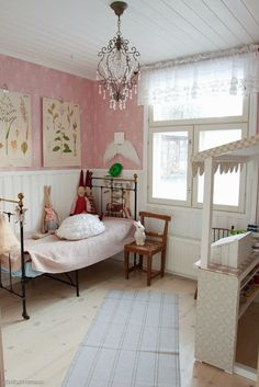 We love the use of a crystal chandelier in a little girl's room. #kids #decor #estella