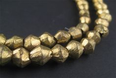 Here is a beautiful strand of brass bicone from Africa. Each bead is handmade individually. These beads more rugged look than ethiopian beads and have a more solid feel to them. Each strand is a long with beads measuring approximately in both dimensions. Brass Necklace, Brass Jewelry, Metal Necklaces, Beaded Jewelry, Vintage Jewelry, Beaded Bracelets, Beading Supplies, Jewelry Supplies, Metal Beads