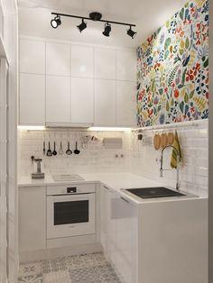 Idee für eine kleine Küche in Weiß mit bunter Tapete als Farbakzent