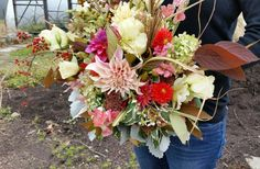 This rustic large fall bouquet is a beauty.  Includes dahlias, hydrangea, lisianthus, dusty miller, viburnum, snapdragons, bittersweet,  and tri-color sage.