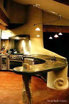 Straw bale house - cool, but I really like the curved counter and set-up of this kitchen.