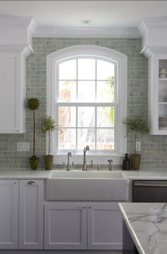 "The backsplash is a 2×5 ceramic tile with a crackle finish. It's by ""Walker Zanger – Mizu, bamboo""."