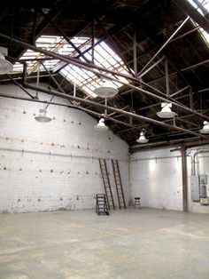 Area 2 is a 2650 sq ft daylight filled warehouse shooting location with adjoining HMU at The 1896 in Brooklyn, NY. Sound Stage, Track Lighting, Ceiling Lights, Studios, York, Decor, Decoration, Decorating, Outdoor Ceiling Lights