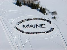 Aroostook County snowmobilers give Maine a shout-out!