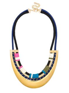 A gilded arc anchors this cool statement necklace, in chic navy with a pop of bright pink. Due to the hand-wrapped nature of this piece, appearance may vary.