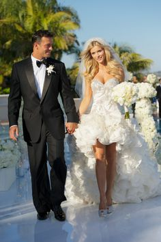 Joanna Krupa's wedding.. Chagoury Couture strapless dress with detachable 6 ft cathedral train, and Giuseppe Zanotti sling back platforms..