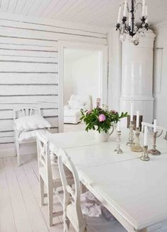 white dining with lovely covered chairs