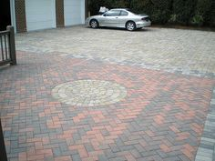 Using different patterns of pavers is a great way of defining different areas of the driveway and making a large driveway look more in scale with the surroundings. Design by Paverstone Design Group.