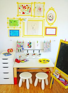 Kids Art Space. Light and Bright. I love the empty yellow frames that are painted right on the wall.