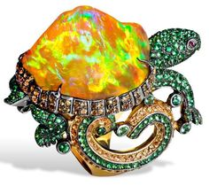 Lydia Courteille. Turtle ring with orange Mexican opal, orange sapphires, green garnets, yellow gold.  Picture c/o The Jewellery Editor.
