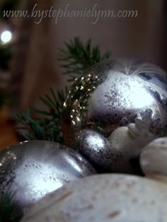 Under The Table and Dreaming: Make Your Own Faux Mercury Glass Ornaments with Acrylics - And if you don't find shiny ones you like, you can spray paint cheap ones with the mirror spray and then start her process.....