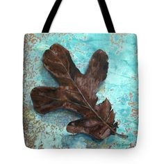 WINTER LEAF Tote Bag for sale by T Fry-Green. $23.00 The tote bag is machine washable, available in three different sizes, and includes a black strap for easy carrying on your shoulder.  All totes are available for worldwide shipping and include a money-back guarantee.  #winterleaf #brown #blue #nature #fall #autumn #leaf #winter #turquoise #fashionbag #tfrygreenart #tfrygreen #homeatlaststudio #art #original  #tote #toteart #fineartamerica
