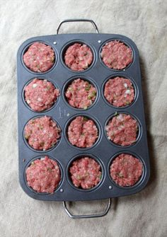 Meatloaf muffins—classic meatloaf with onions, peppers, eggs and seasonings baked in convenient, serving-size muffin pans.