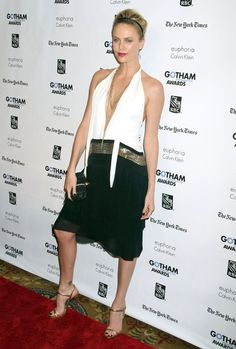 Charlize Theron Cocktail Dress - Charlize Theron is never one to disappoint on the red carpet. The glowing actress made an appearance at the Gotham Independent Film Awards in NYC wearing a sultry black-and-white chiffon gown with gold accents.
