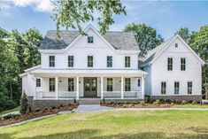 The Best Classic White Farmhouse Exterior Inspiration - A huge collection of Farmhouse inspiration that is classic yet completely on-trend, showcasing white exteriors and some modern farmhouse touches. A huge collection of Farmho White Farmhouse Exterior, Colonial Exterior, Farmhouse Plans, Farmhouse Design, Farmhouse Style, Farmhouse Homes, Colonial House Exteriors, Cafe Exterior, White Exterior Houses
