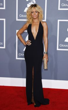 Rihanna made jaws drop in a black silk Giorgio Armani gown. The plunging neck, high slit and open back made the 23-year-old look super sexy. Jacquie Aiche body necklaces upped that sex appeal even more. Rihanna wore Neil Lane jewels, including a diamond and gold snake armlet, gold rings and gold triangle earrings. She finished off the look with Christian Louboutin shoes and a Jimmy Choo clutch.
