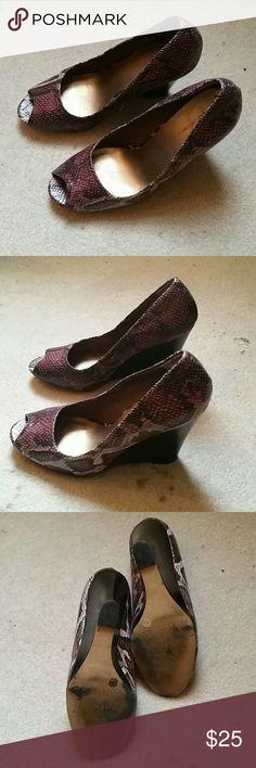 "BCBGeneration snakeskin shoes BCBGeneration snakeskin shoes Maroonish colors 4"" Wedge heel Peep toe Very comfortable! Good condition! BCBGeneration Shoes Heels"